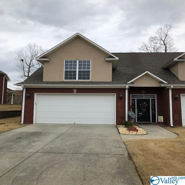 Photo of home for sale at 64 Chittom Wood Drive, Guntersville AL