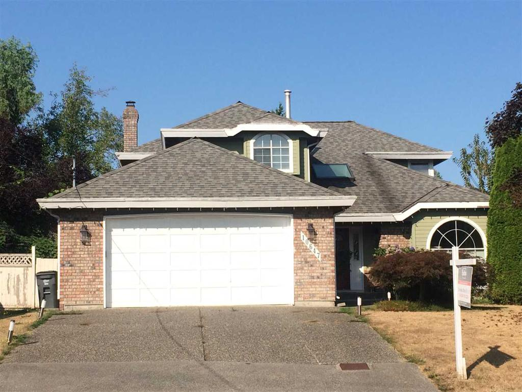 Photo of home for sale at 10647 168, Surrey BC