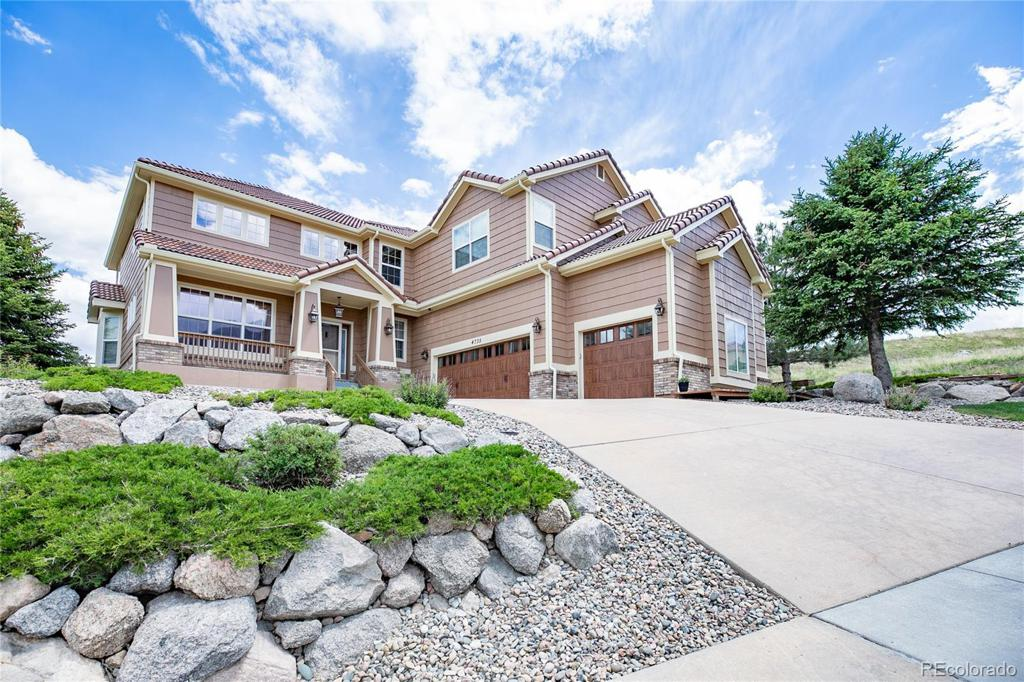 Photo of home for sale at 4735 Broadmoor Bluffs Drive, Colorado Springs CO