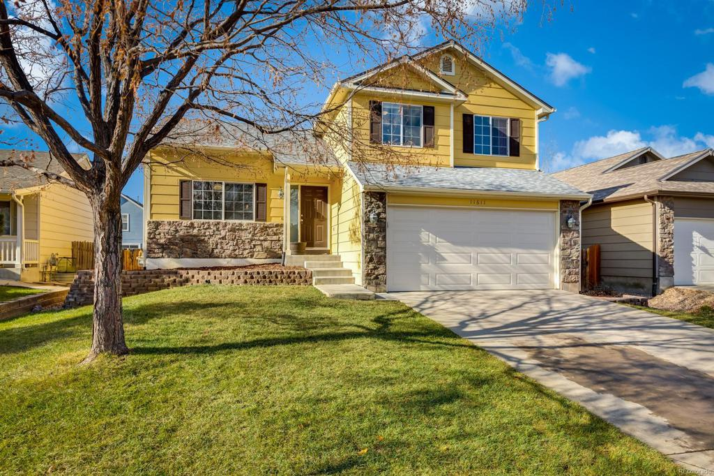 Photo of home for sale at 11611 Oswego Street, Commerce City CO
