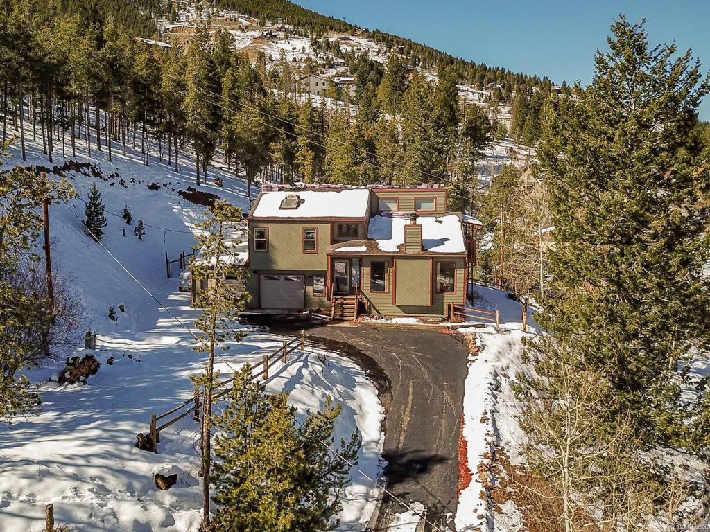 Photo of home for sale at 659 Hyland Drive, Evergreen CO