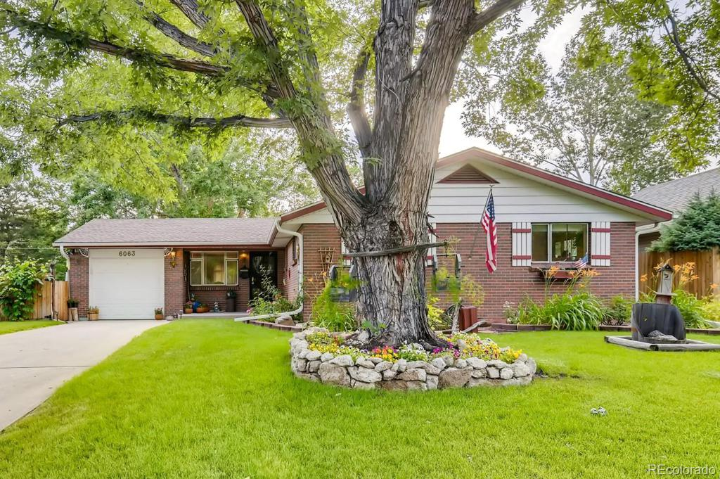 Photo of home for sale at 6063 Holland Street, Arvada CO