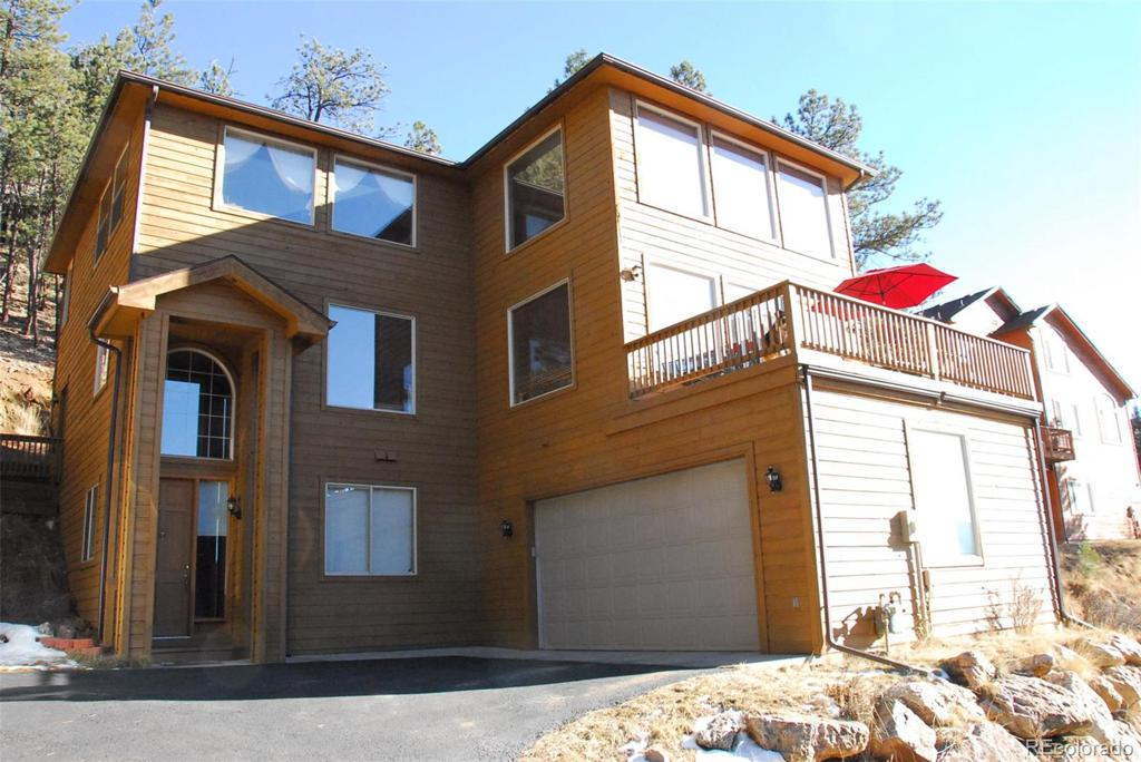 Photo of home for sale at 3106 Buttercup Lane, Evergreen CO