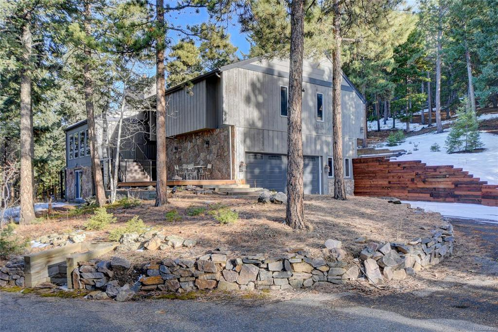 Photo of home for sale at 8320 Grizzly Way, Evergreen CO
