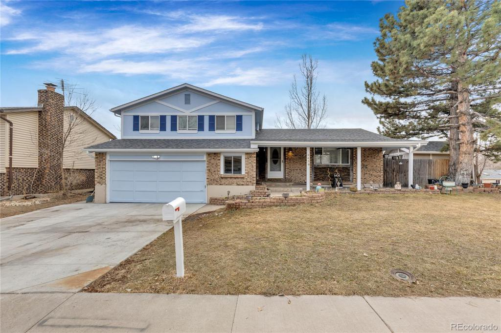 Photo of home for sale at 9438 Brittany Avenue W, Littleton CO