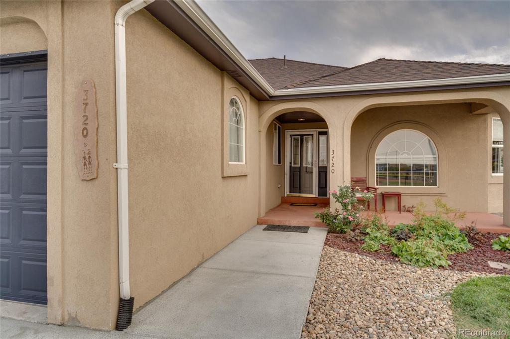 Photo of home for sale at 3720 66th Avenue W, Arvada CO