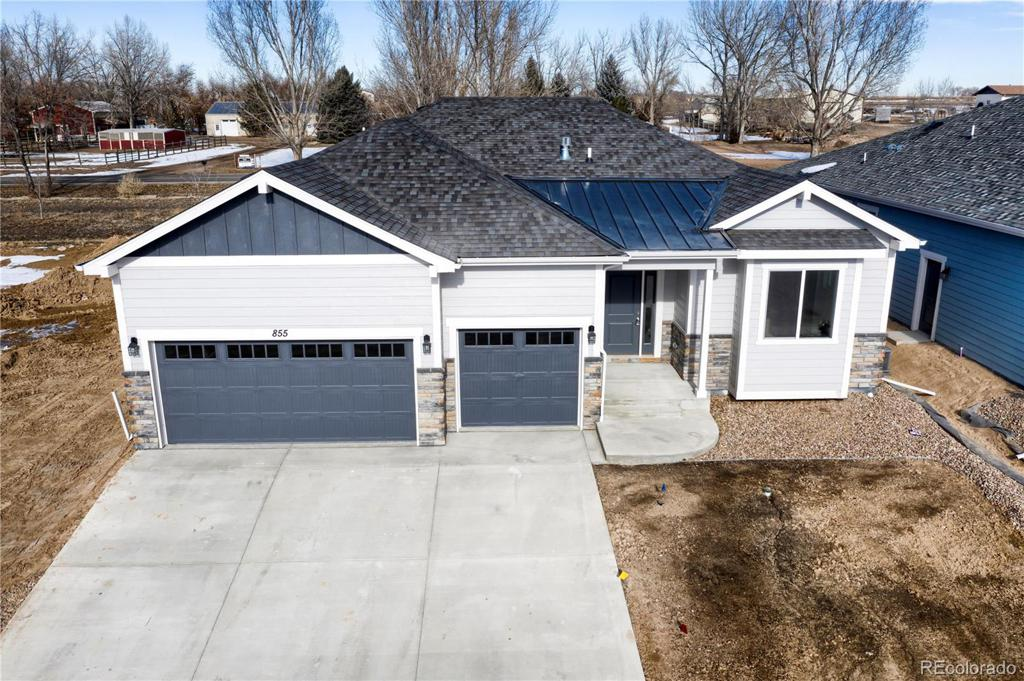 Photo of home for sale at 855 Shirttail Peak Drive, Windsor CO