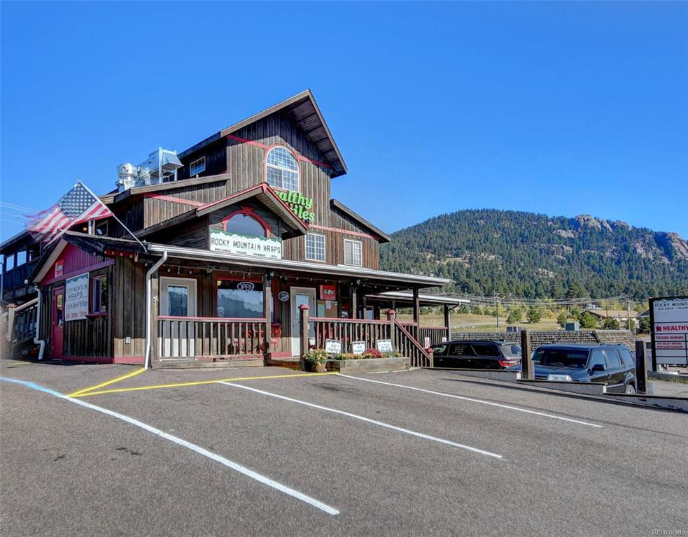 Photo of home for sale at 25997 Conifer Road, Conifer CO