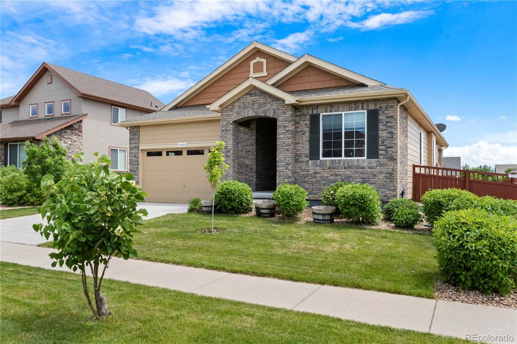 Photo of home for sale at 19400 61st Drive E, Aurora CO