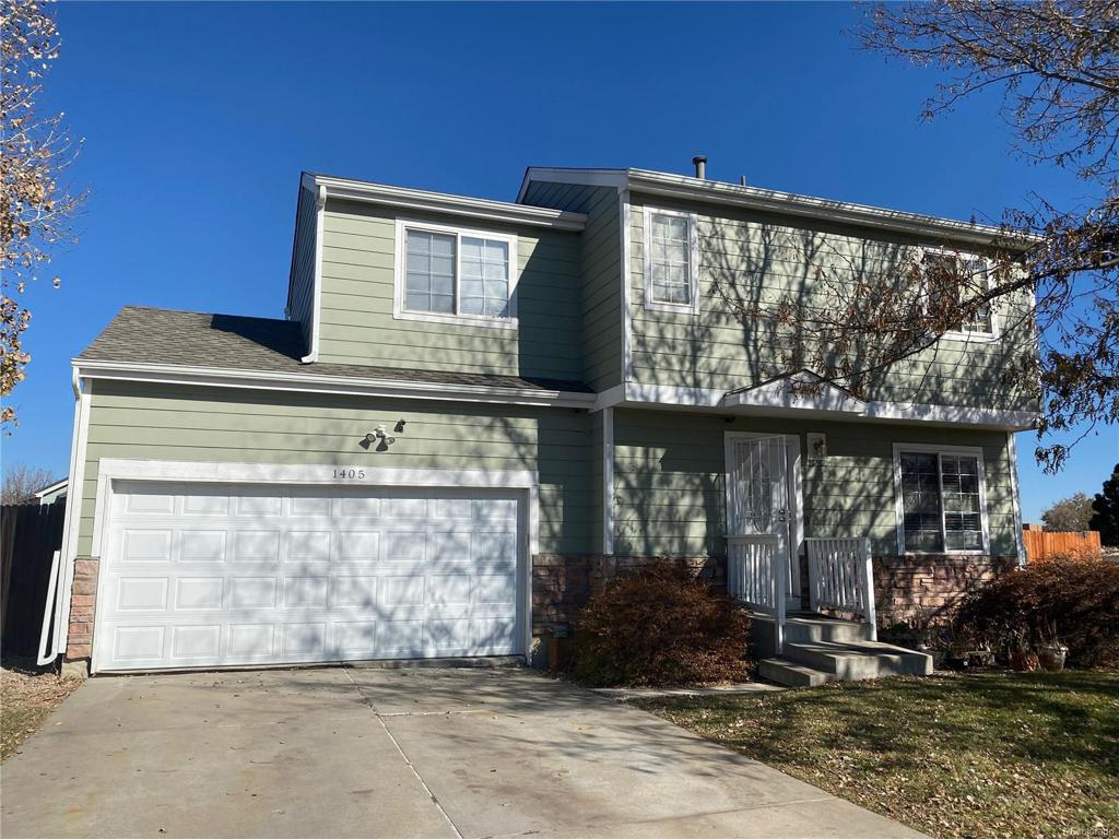 Photo of home for sale at 1405 Pitkin Court S, Aurora CO