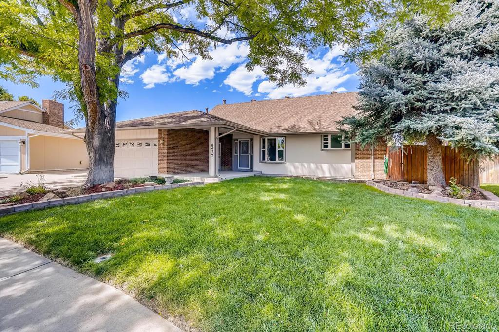 Photo of home for sale at 8477 74th Place W, Arvada CO