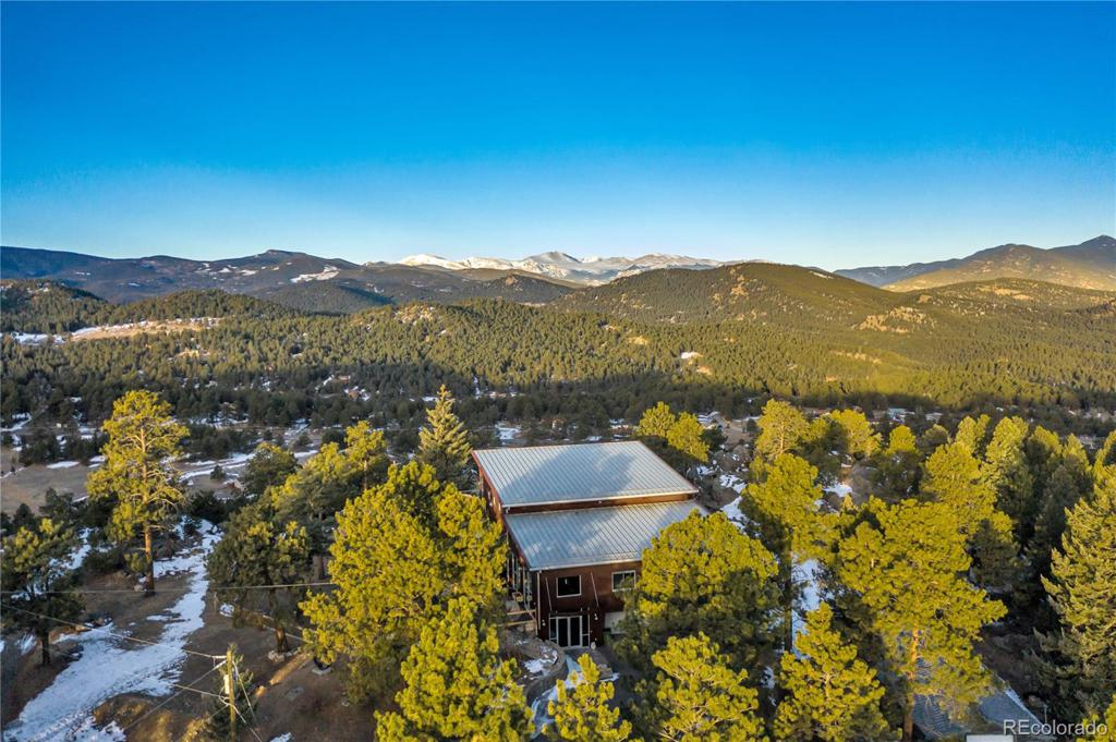 Photo of home for sale at 6199 Skyline Drive S, Evergreen CO