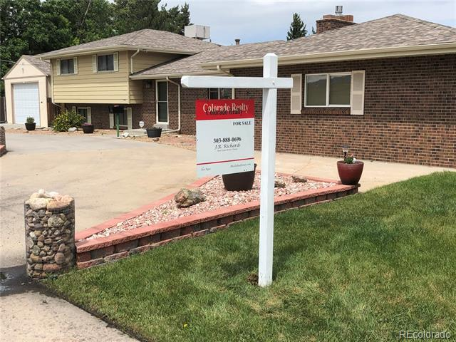 Photo of home for sale at 7840 Simms Street, Arvada CO
