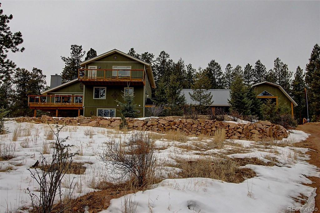 Photo of home for sale at 331 Woodside Drive, Pine CO