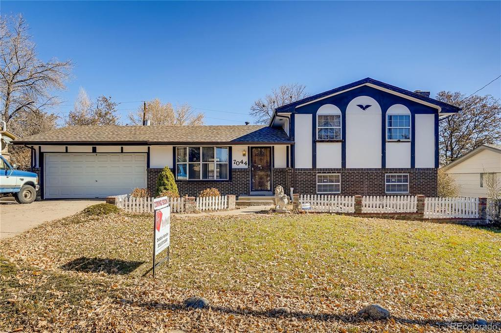 Photo of home for sale at 7044 Ingalls Court, Arvada CO