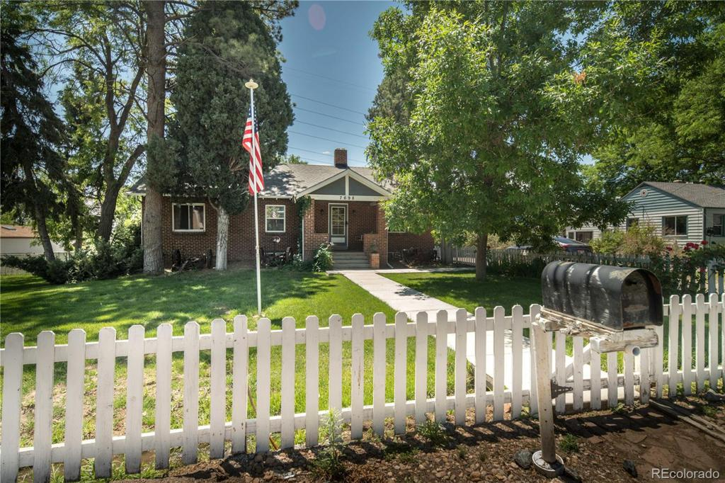 Photo of home for sale at 7698 10th Avenue W, Lakewood CO
