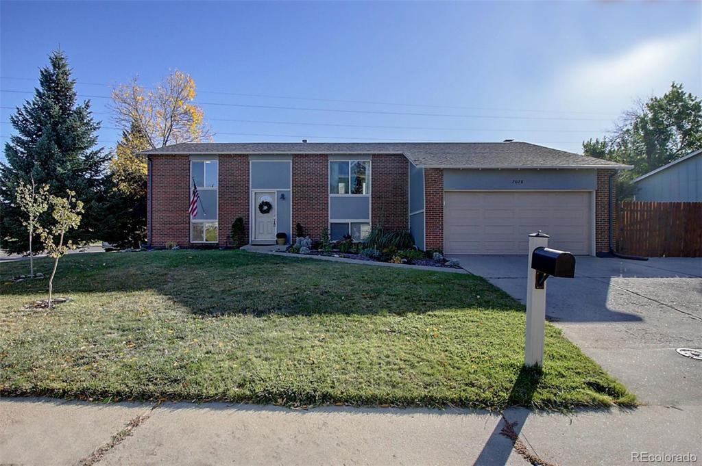 Photo of home for sale at 7078 Van Gordon Court, Arvada CO