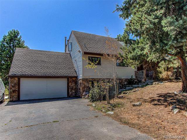 Photo of home for sale at 30330 Palomino Drive, Evergreen CO