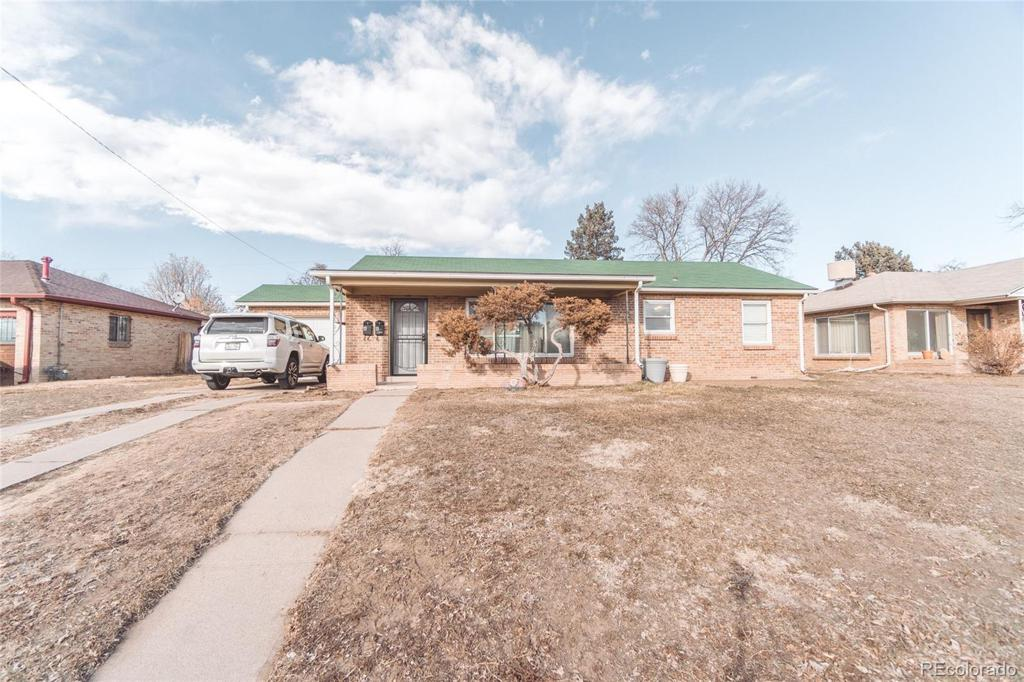 Photo of home for sale at 5335 Thrill Place E, Denver CO