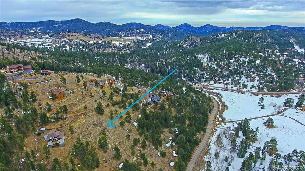 Photo of home for sale at 7384 Heiter Hill Drive, Evergreen CO