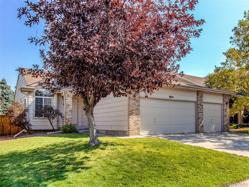 Photo of home for sale at 8854 Miners Street, Highlands Ranch CO
