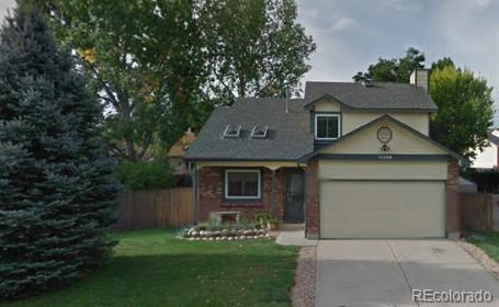 Photo of home for sale at 11236 Bowles Place W, Littleton CO