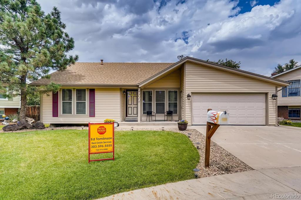 Photo of home for sale at 7477 Holland Court, Arvada CO