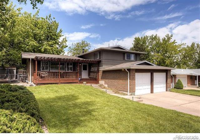 Photo of home for sale at 10511 Romblon Way, Northglenn CO