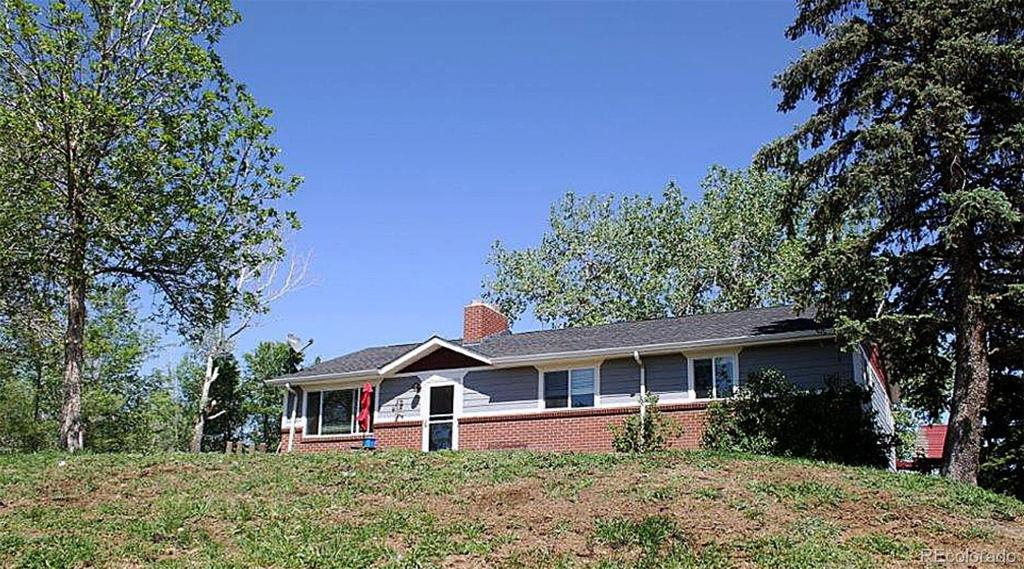 Photo of home for sale at 11102 Pine Drive N, Parker CO