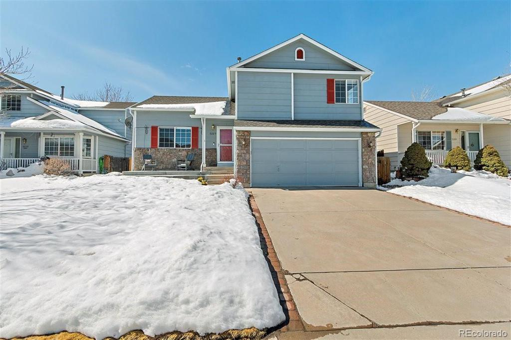 Photo of home for sale at 5223 Parfet Way S, Littleton CO