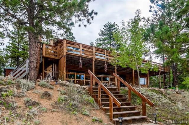 Photo of home for sale at 324 Stage Coach Drive, Bailey CO
