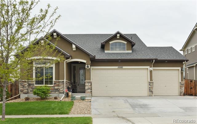 Photo of home for sale at 10580 Worchester Drive, Commerce City CO