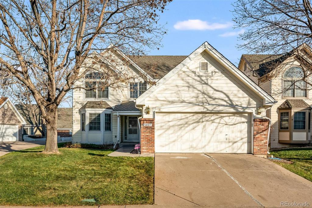 Photo of home for sale at 5657 Iliff Drive W, Lakewood CO