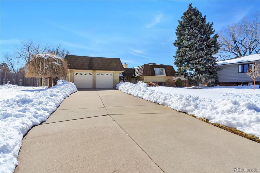 Photo of home for sale at 6504 Milan Place E, Denver CO