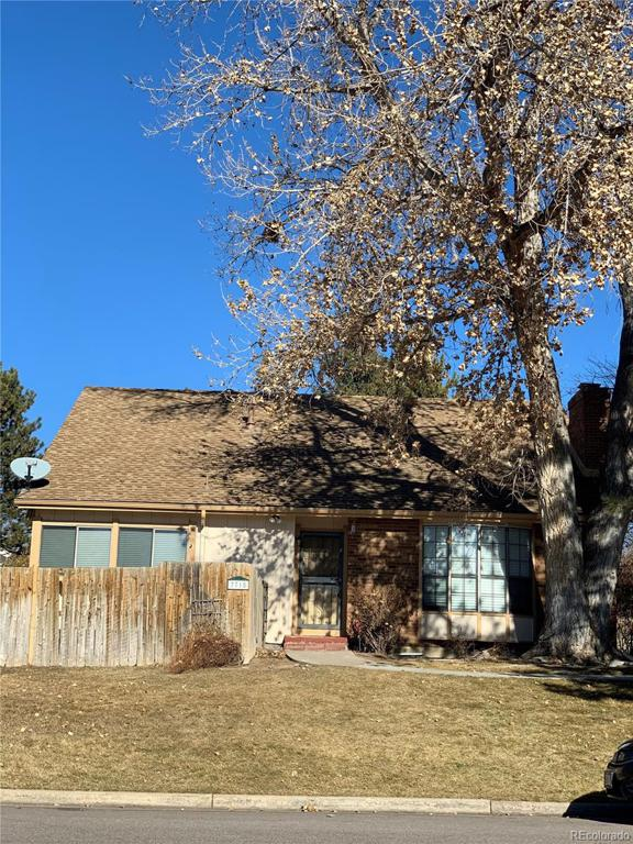 Photo of home for sale at 7715 Jamison Drive E, Centennial CO