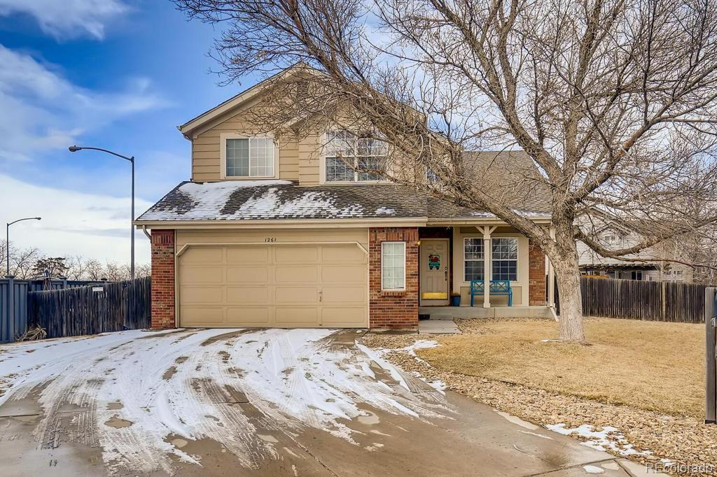 Photo of home for sale at 1261 135th Place E, Thornton CO
