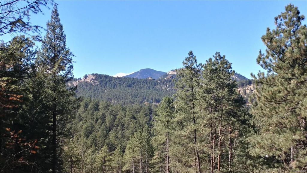 Photo of home for sale at 5177 Mountain Vista Lane, Evergreen CO