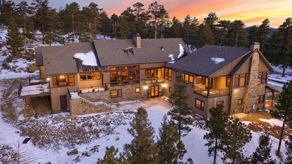 Photo of home for sale at 29155 Summit Ranch Drive, Golden CO