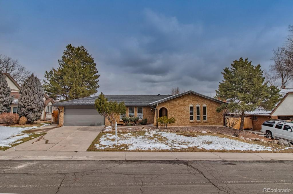 Photo of home for sale at 7573 Elmhurst Drive W, Littleton CO