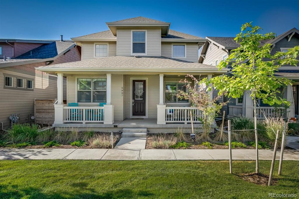 Photo of home for sale at 5887 Boston Court, Denver CO