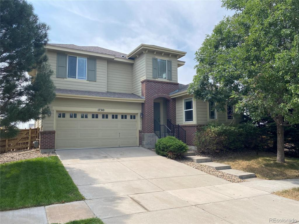 Photo of home for sale at 17310 104th Place E, Commerce City CO