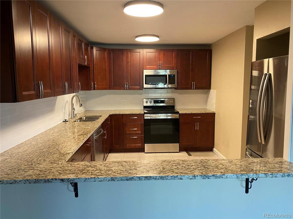 Photo of home for sale at 595 Alton Way S, Denver CO