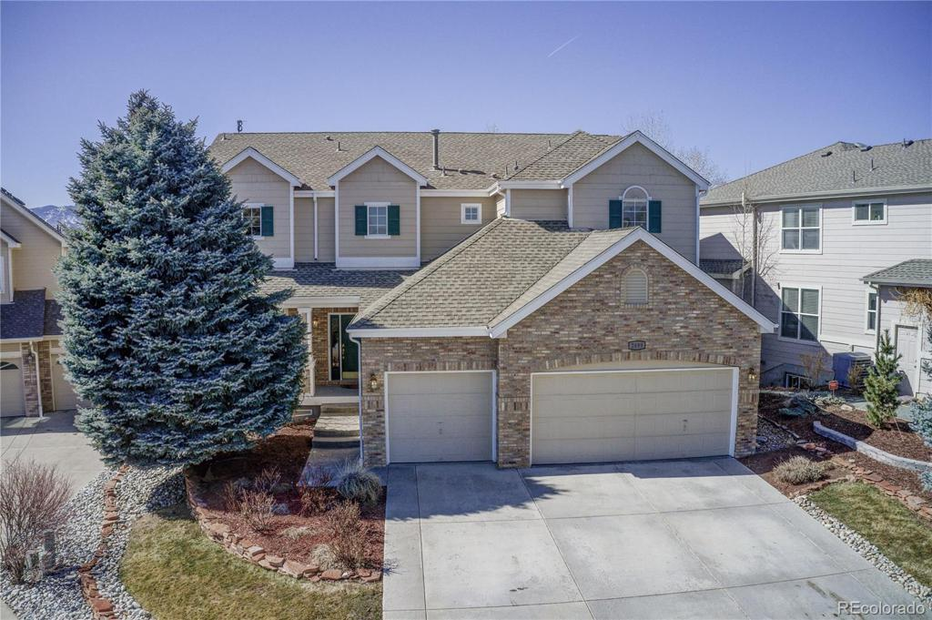 Photo of home for sale at 2499 Newcombe Street S, Lakewood CO
