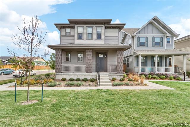 Photo of home for sale at 5811 Boston Court, Denver CO
