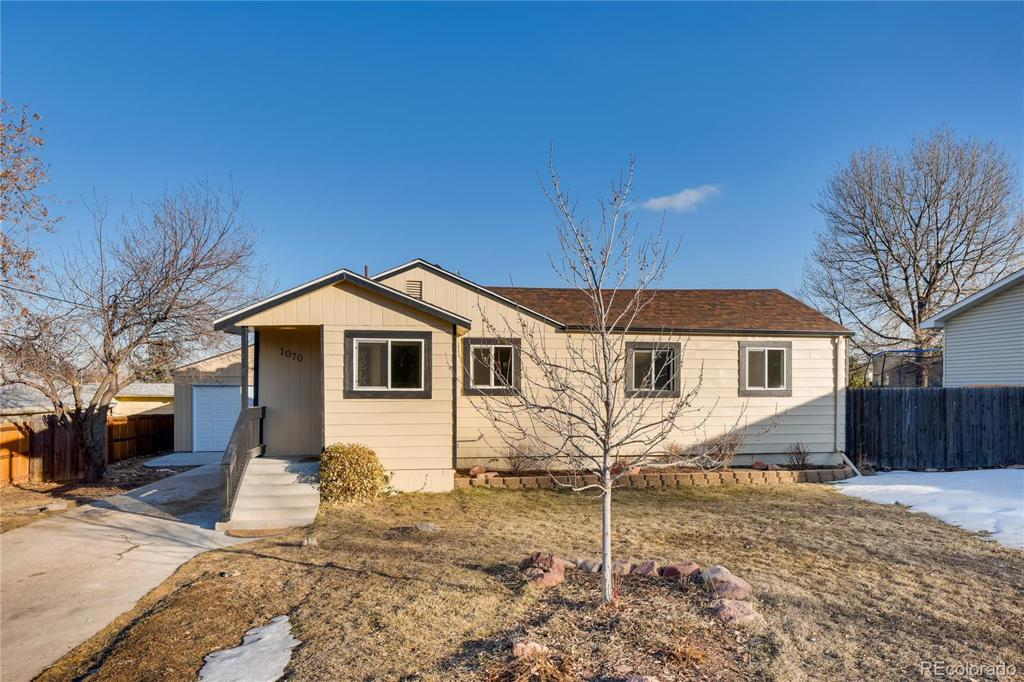 Photo of home for sale at 1070 Urban Street, Lakewood CO