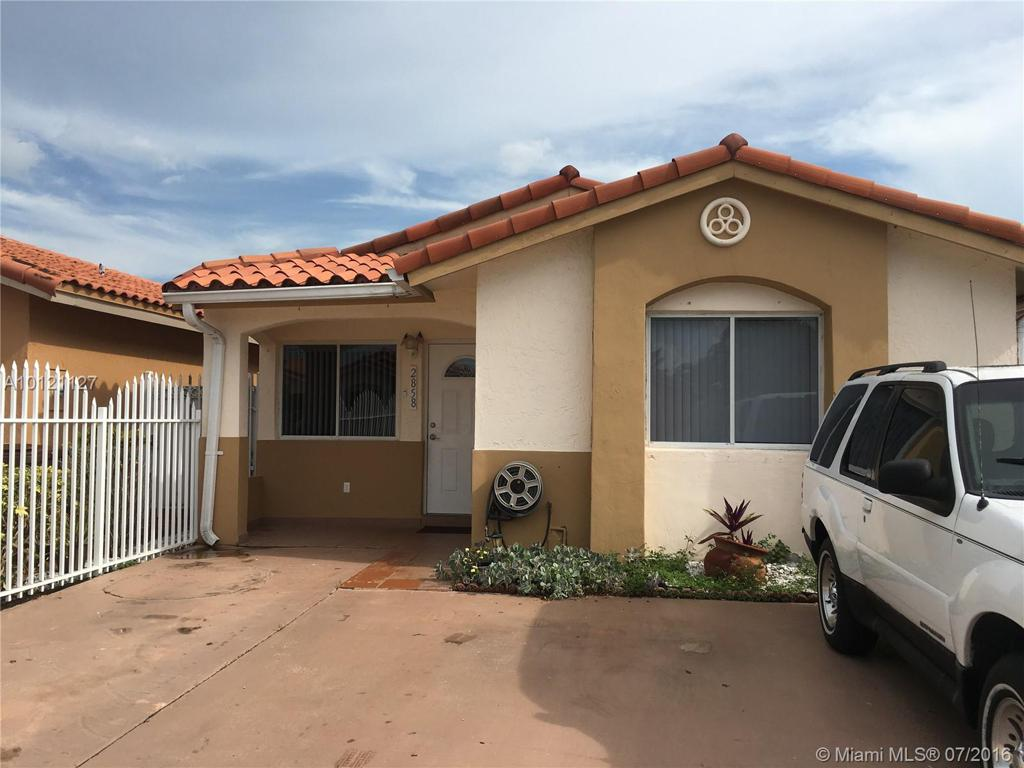 Photo of home for sale at 2858 74th Pl W, Hialeah FL
