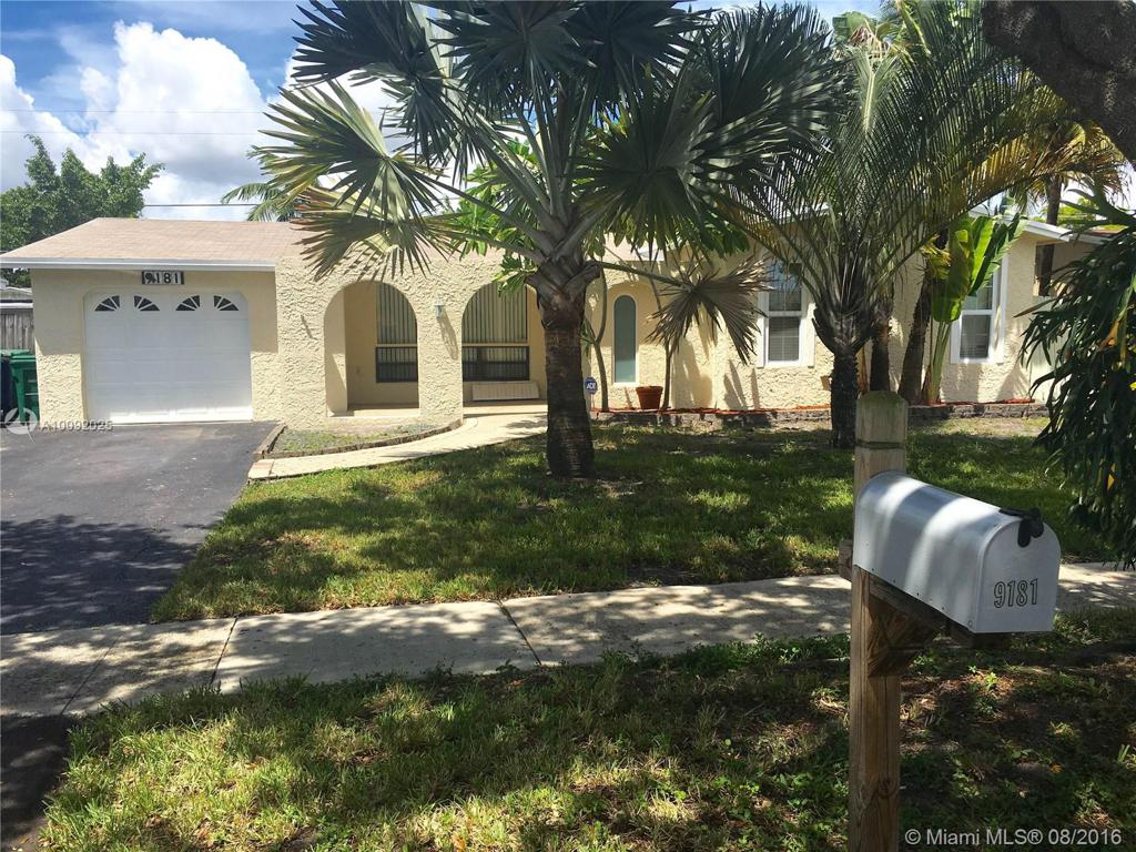 Photo of home for sale at 9181 55th Ct SW, Cooper City FL