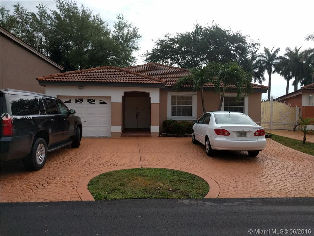 Photo of home for sale at 8251 197th St NW, Miami Gardens FL