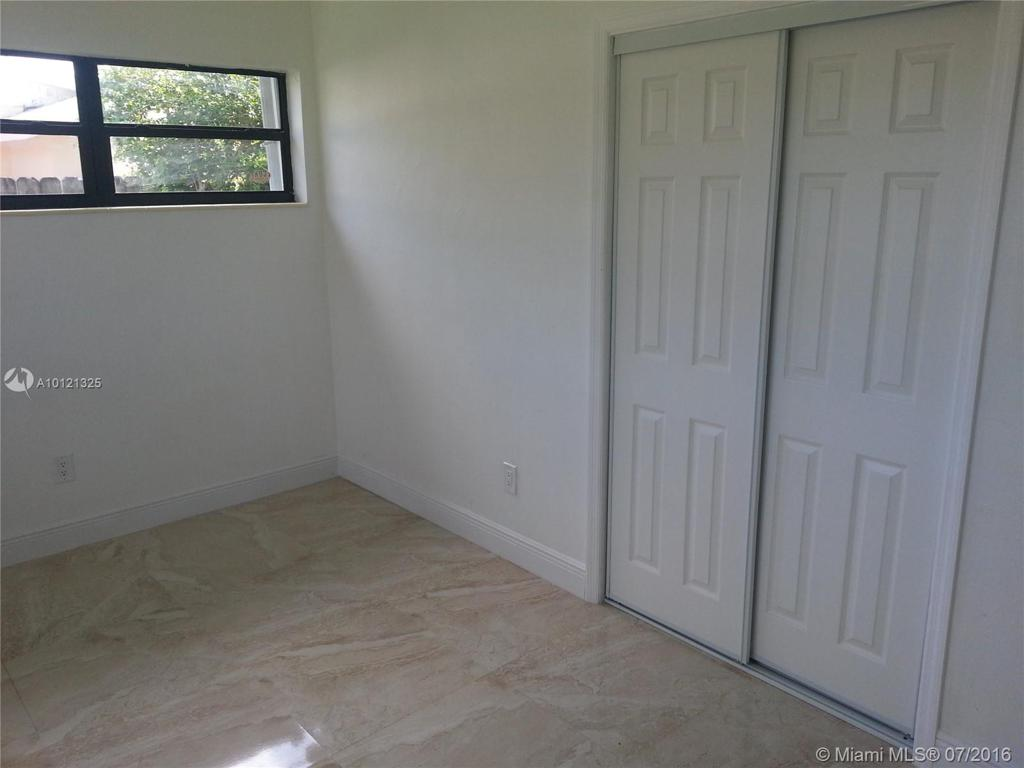 Photo of home for sale at 19511 Gulfstream Rd, Cutler Bay FL