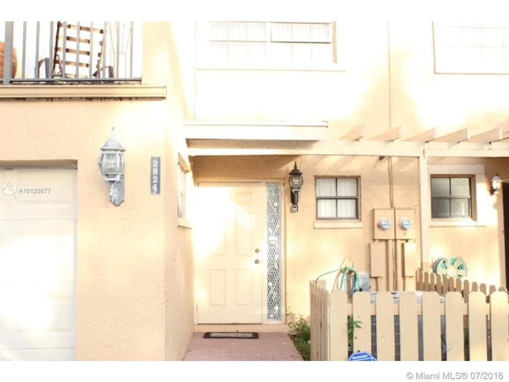 Photo of home for sale at 2824 80th Ave NW, Sunrise FL